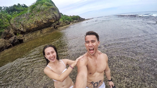 Taking a wacky selfie with the Magpupungko rock in the background.