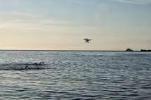 Triathlon practice while our drone, Drogon, flies with them.